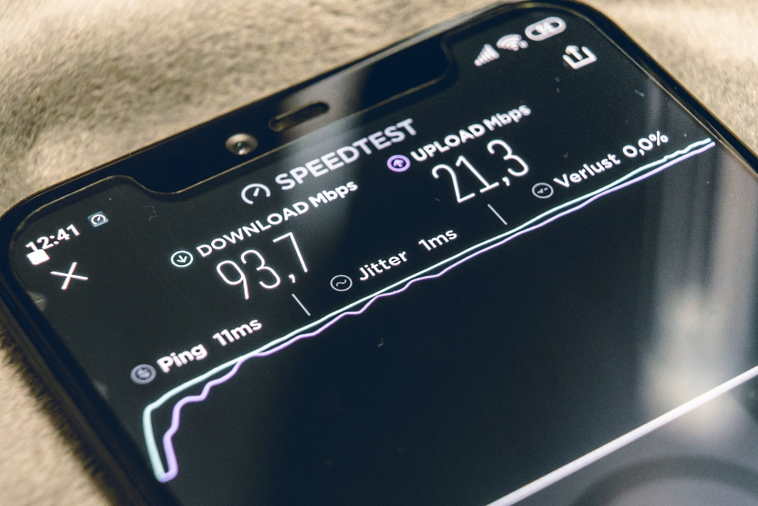 an image of a mobile phone showing data speed to represent mobile service providers and their data service.